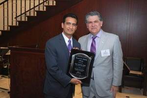 John Marshall Law School Clinical Professor Damian Ortiz (left) accepts the Community Service Award from Hispanic Lawyers Association of Illinois President Federico Rodriguez at a May reception.