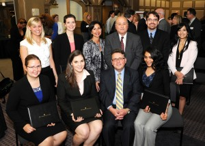 At The John Marshall Law School Alumni Association annual meeting, scholarships and book awards were presented to outstanding students. Honorees are (seated from left) Magdalena Wilk; Mary Walters; Michael Favia, outgoing association president; Suhey Ramirez; and (standing, from left) Margaret Hillmann, Katherine Gipe, Circuit Court of Cook County Judge Regina Scannicchio, association president; Donald Rubin, scholarship committee member; Andrew Symns; and Sarbani Mukherjee.