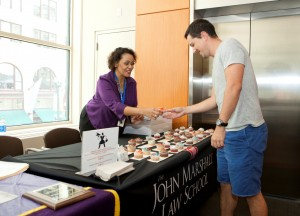 Yara Santana, director of Financial Aid, offers a treat to 3L Dan Noonan as the law school marked Constitution Day on Sept. 17.