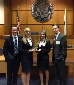John Marshall Law School Center for Advocacy and Dispute Resolution proudly announces the second place win by teammates (from left) David Resis, Polina Kostylev, Brittany Anselmo and Andrew McElligott at the National Trial Advocacy Competition Oct. 24-26,2013, in Detroit.  The team represented the defense and prosecution in a criminal law problem loosely based on the facts of the 2013 Blade Runner Case in South Africa.  Team coaches were Patrick Keegan (JD '10) and Jeannie LaBarbara (JD '11).