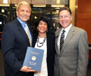 Chicago Alderman Bob Fioretti (left) presents a resolution honoring the Fair Housing Legal Clinic to Clinic Director Allison Bethel and Bill Beach, chief development officer.