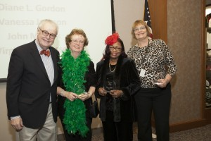 Dean John E. Corkery helps Virginia M. Russel, Vanessa Jackson, and Diana L. Gordon mark 15 years of service at the law school. Honoree Claire T. Durkin and John M. Park (not pictured) also marked 15 years.