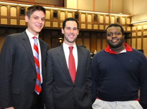Patrick J. Molinari (left), who received Best Brief honors, and Adam P. Brunell, and Jeremy Lemmons (right) Best Oralist winner, are congratulated by Adam P. Brunell (center), chief justice of the Moot Court Honors Program.