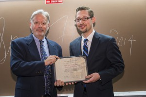 Michael Bradtke (right) accepts the honorable mention for the Gay and Lesbian Legal Alliance initiatives from Associate Dean William Powers.