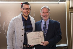 Themis Katris (left) accepts from Associate Dean William Powers the honorable mention recognizing the outstanding programs hosted by the Hellenic Law Student Association.
