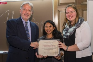 "The Student Association of Immigration Law won the ""area of law"" award.  Associate Dean William Powers presents the honor to Louise Nicole Vil (center), incoming president, and Magdalena Wilk (right), president for 2013-14."