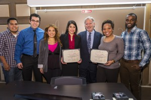 The Black Law Students Association (BLSA) and the Latino Law Student Association (LLSA) tied by earning the most points for their events, and most points as the most active minority organization. The honors were presented by Associate Dean William Powers (third from right) to (from left) LLSA representatives Andres Ramirez; Brian Mendez; Italia Lima, incoming president; and Jennifer Crespo, the 2013-14 president; and  BLSA 2013-14 president Kristin Johnson and incoming BLSA president Dominic Spence.