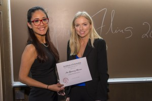 Iris Gutierrez Berrios (left) will benefit from funds raised at the Public Interest Auction hosted by the Student Bar Association.  Colleen Jordan (right), the Chicago Bar Association representative, made the presentation on behalf of the auction organizing committee.