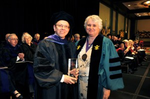 Professor Ardath Hamann, chair of the Adjunct Faculty Committee, presents the Adjunct Teaching Award to Lester Finkle.