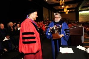 Associate Dean Ralph Ruebner (right) prepares to hand Professor David Sorkin the Dedicated Service Award.