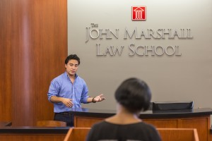 Current JMLS students give advice to the college students during oral advocacy practice sessions.
