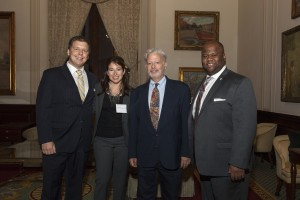 Past SBA presidents Michael Reever (JD '11) and Anna Gonis O'Connor (JD '06) speak with Associate Dean William Powers (LLM '02) and current SBA president Raymond Rushing.