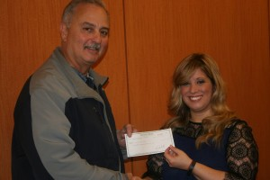 Animal Law Society member Mara Salerno proudly presents the Chicago Police Department with a check from the funds raised.