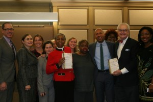 John Marshall faculty and staff pose with Bryan Stevenson, who was in Chicago to promote his new book Just Mercy.
