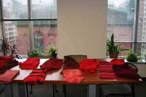 The finished scarves will be sent off to foster youth as part of a Valentine's Day care package.