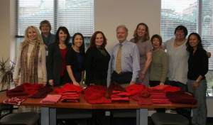 John Marshall faculty and staff stand proudly behind their homemade gifts for the project. Professor Maureen Collins led the effort.