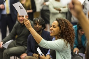 3L RiKaleigh Johnson bids on an item at the annual Public Interest Auction hosted on April 23.