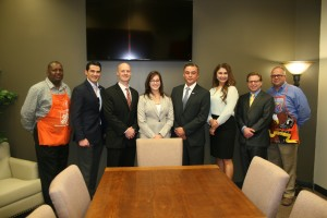 Representatives of the Student Veterans of America and The Home Depot Foundation gather to open the new Student Veterans Resource Center space.